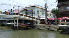 A bridge and boats at the Tha Kha Floating Market Stock Footage