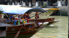 Tourists in a boat at the Tha Kha Floating Market Stock Footage