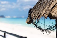 Grass leaf palm sun umbrella with sea background Stock Photos