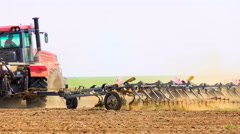 Tractor rides on the field Stock Footage