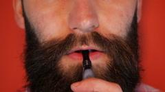 Man with a beard smoking an e-cigarette Stock Footage