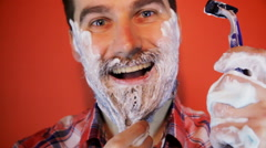 Man put on his long beard shaving foam Stock Footage