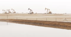 Row Of Many Working Oil Pumps (4K) - stock footage