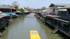 Overview from the Tha Kha Floating Market with a boat passing by Stock Footage