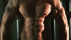 Muscular man show muscules on torso Stock Footage