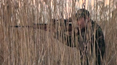 A man hunting with rifle - stock footage