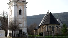 Bell tower and  reformed church in Plesivec, Slovakia Stock Footage