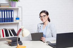 The girl works in an Office at a computer Stock Photos