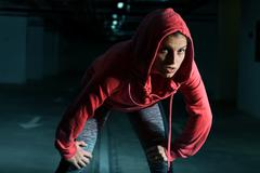 Fitness Athlete Runner Woman ready for running. Active Healthy lifestyle. Stock Photos