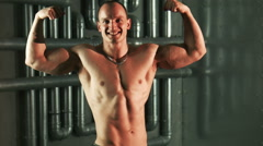 Strong muscular man exercising with expander Stock Footage