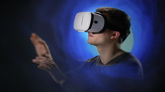 Young man exploring Virtual Reality Stock Footage