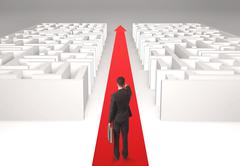 Businessman in labyrinth - stock photo