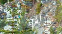 Man Riding Zipline in Ruskeala Marble Canyon Stock Footage