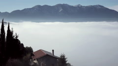 4K rural house on edge of cliff, fog,morning, mountain view Stock Footage