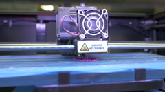 Printing with Plastic Wire Filament on 3D Printer, dolly shot Stock Footage