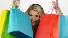Beautiful girl with colorful packages. Shopping. White Stock Footage