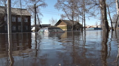 Car was flooded with water during spring flooding in village Stock Footage