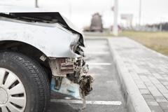 Broken car after the accident in  foreground Stock Photos