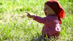Happy little girl on the meadow in summer day Stock Footage