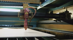Laser cutting machine at work, pan Stock Footage