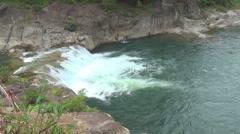 Yang Bay waterfall. Vietnam. sunny day. waterfall rapids. water runs down. - stock footage