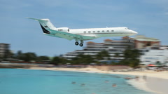 Private jet landing at Saint Martin airport. Stock Footage