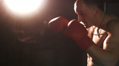 Sexy topless bodybuilder boxing in gloves - stock footage