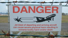 Sign warning of danger of jet blast. Saint Martin, Caribbean. Stock Footage