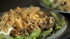 Caesar salad in a plate Stock Footage