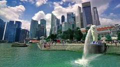 Singapore. Circa March 2016. Time lapse of the tourists around Merlion and Stock Footage