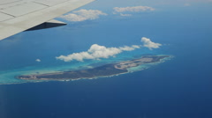 Flying over Anegada in the British Virgin Islands. View of jet wing. - stock footage