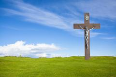 Jesus Christ on the cross and summer grass with blue sky Kuvituskuvat