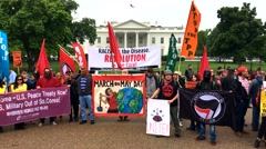Socialists, unions and immigrant rights groups at White House. - stock footage