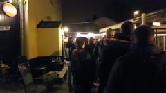RAASEPORI, UUSIMAA, FINLAND, MARCH 28 line outside of santa fe bar and night  - stock footage