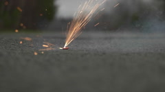 Firecracker Lit and Going Off in Slow Motion. Stock Footage