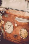 Retro car dashboard - stock photo