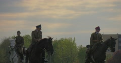 Three Military Officers on Horses Are Moving to a Camera and Turning Around Stock Footage