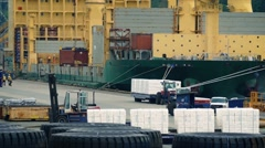 Busy Port With Workers Loading Ship Stock Footage