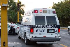 Cancun, Mexico - 2 January 2016: Ambulance car at the street road with blinki Stock Photos