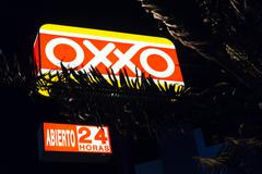 The OXXO franchise of convenience stores at Zona Hotelera in the   evening - stock photo