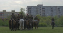 Horse Riders Start to Ride Away in Line Military Parade of Cavalry Men in Old Stock Footage
