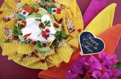 Cinco de Mayo party table with nachos platter. Stock Photos