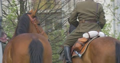 Man, Dressed in a Military Uniform, Sits on Horse Stock Footage