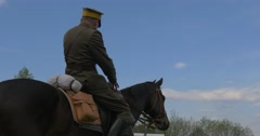 Soldier on Horse is Going to Ride Middle Aged Man in Authentic Vintage Military Stock Footage