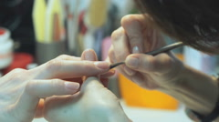 A female master makes manicure of hands girl Stock Footage