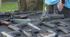 Military Men Demonstrate Versions of Fire-Arms During City Day Celebrating in - stock footage