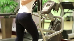 Physical activity helps burn up calories. Woman trains in gym Stock Footage