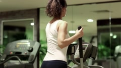 Woman trains in gym. Woman goes in for sports Stock Footage