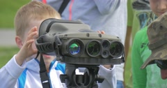 A Child Looks Through a Military Optical Instrument. Stock Footage