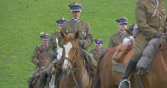 Military Officers Are Riding Horses in City Park in Summertime Stock Footage